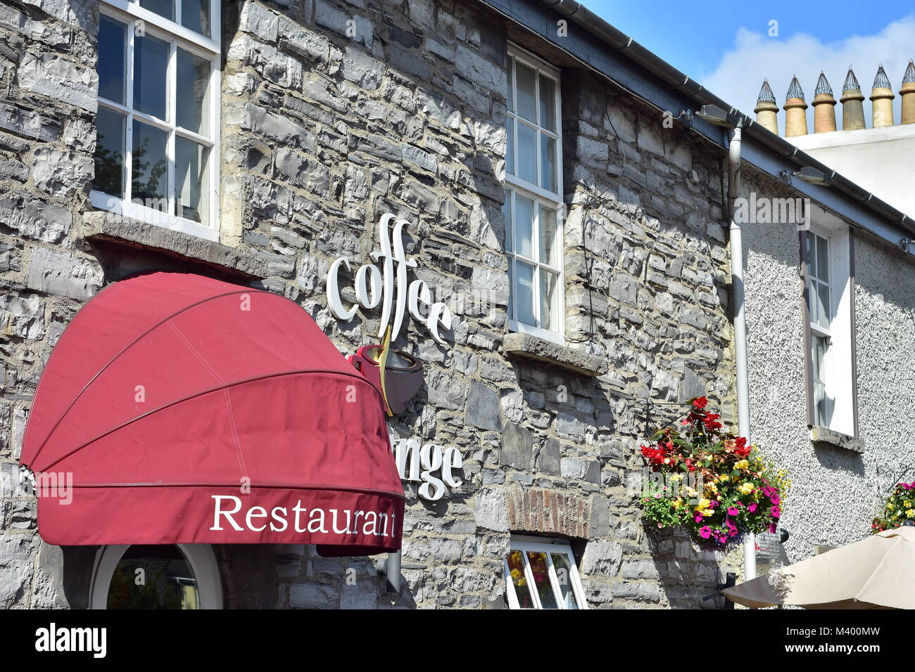 Restaurant in vintage stone house in town of Maynooth in Ireland. - Stock Image