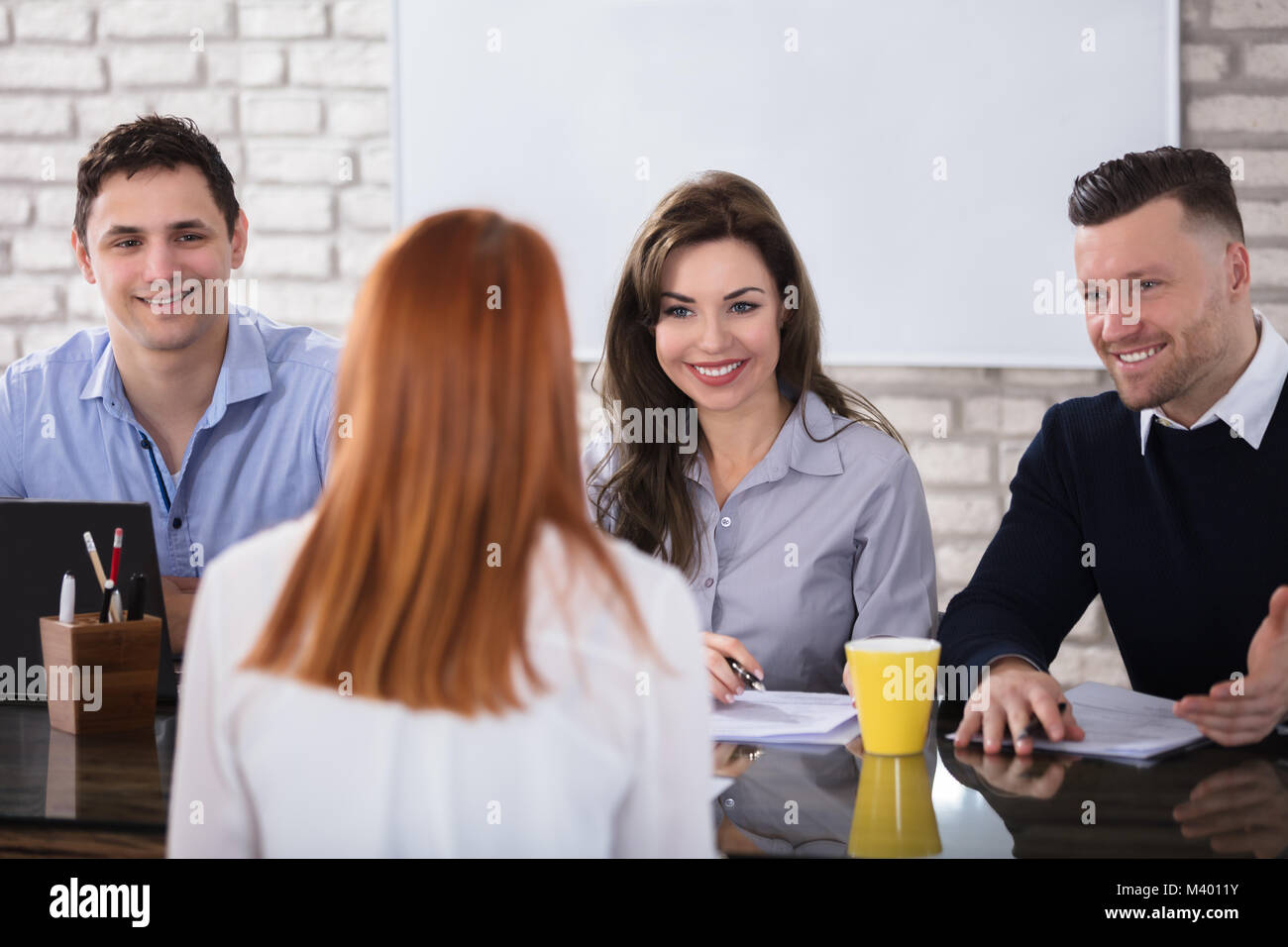 Rear View Of A Woman At Job Interview - Stock Image