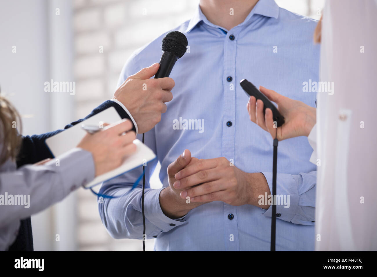 A Businessman Answering Questions During The Press Conference - Stock Image
