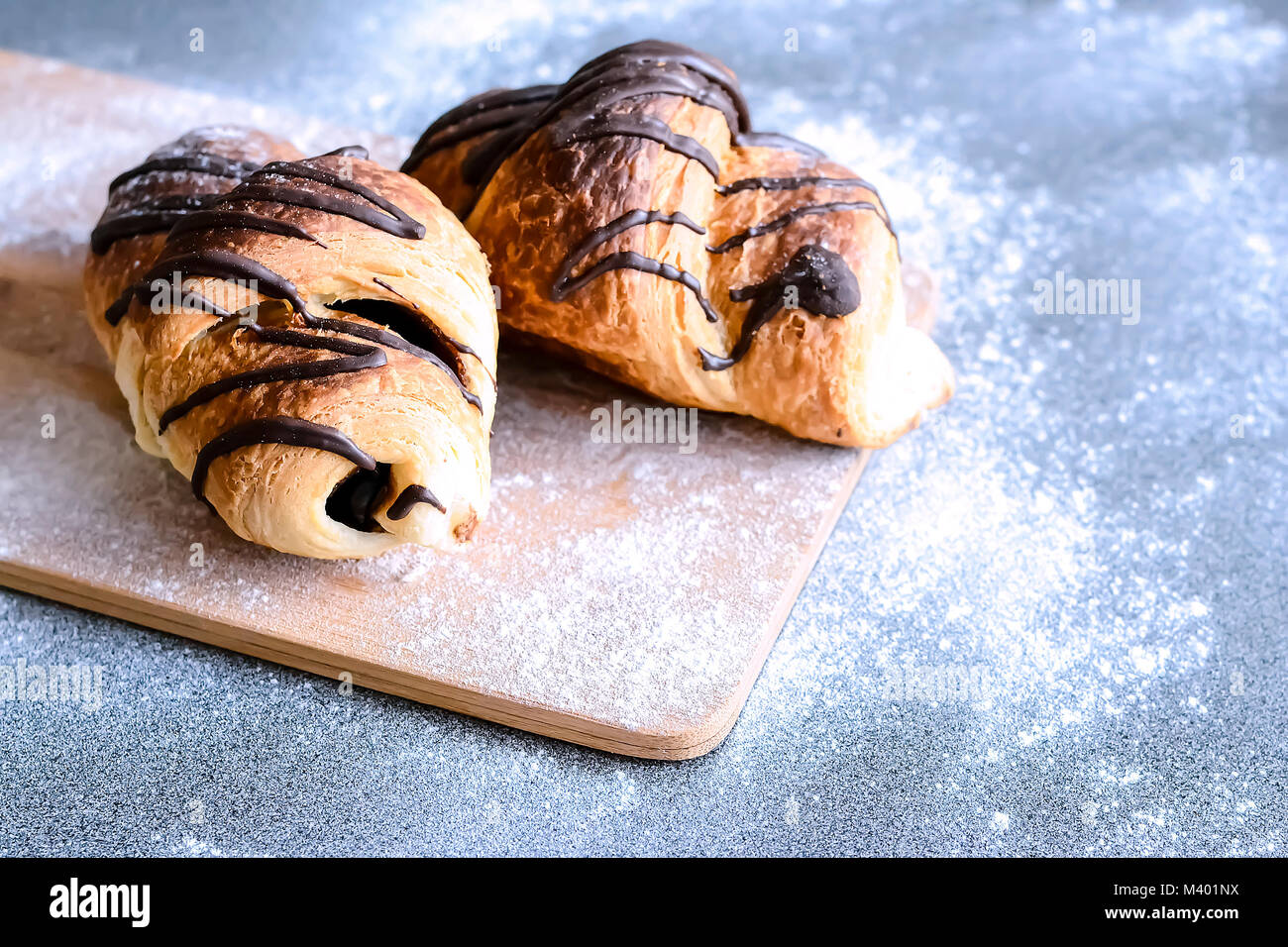 Fresh croissants with chocolate on the table. Delicious Breakfas - Stock Image