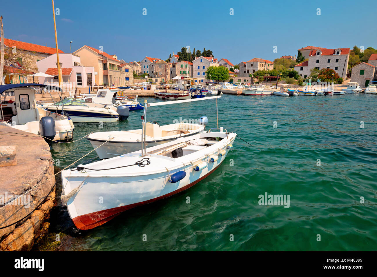 Island of Prvic turquoise harbor and waterfront view in Sepurine village, Sibenik archipelago of Croatia - Stock Image