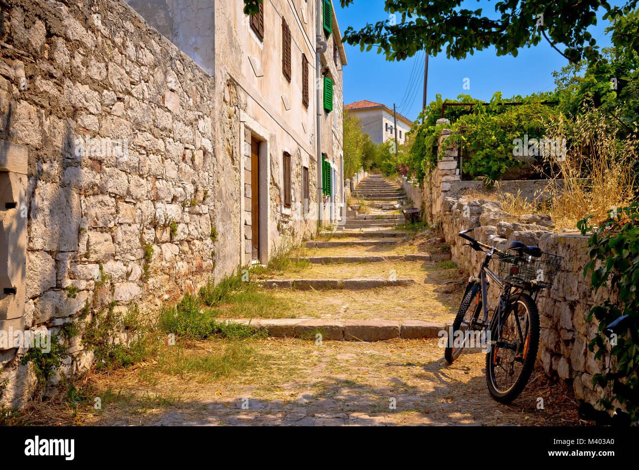 Old stone mediterranean village walkway on Prvic island, Dalmatia region of Croatia - Stock Image