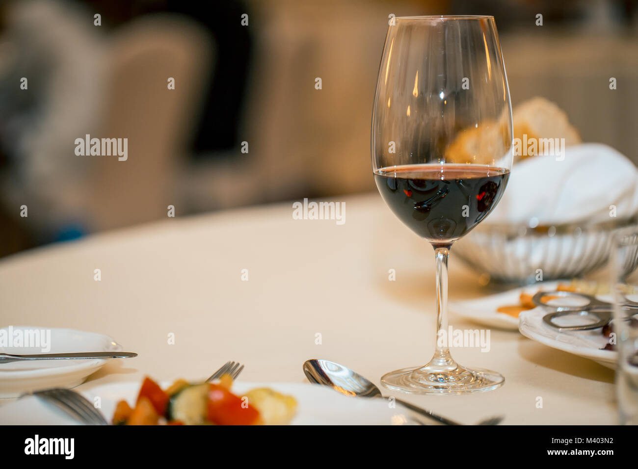 glass of red wine and dinner on a set table. a restaurant. Copy space. waiting for the meeting & glass of red wine and dinner on a set table. a restaurant. Copy ...