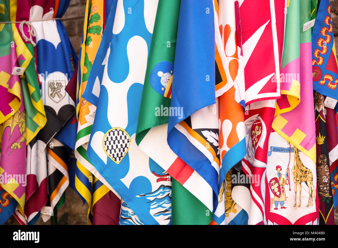 Flags of the Siena contrade (districts), Palio festival background, in Siena, Tuscany, Italy Stock Photo