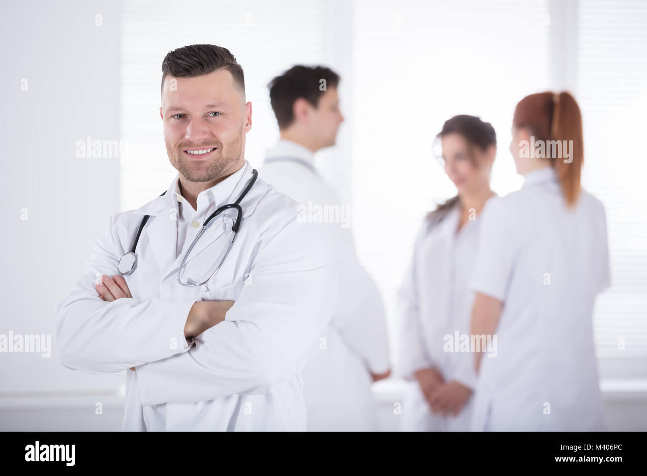 Portrait Of Confidence Professional Male Doctor With Stethoscope - Stock Image