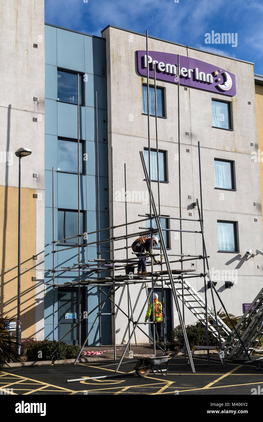 A Premiere inn at Paignton Devon with scaffolding being constructed.city centres to seafronts, we're opening new - Stock Image