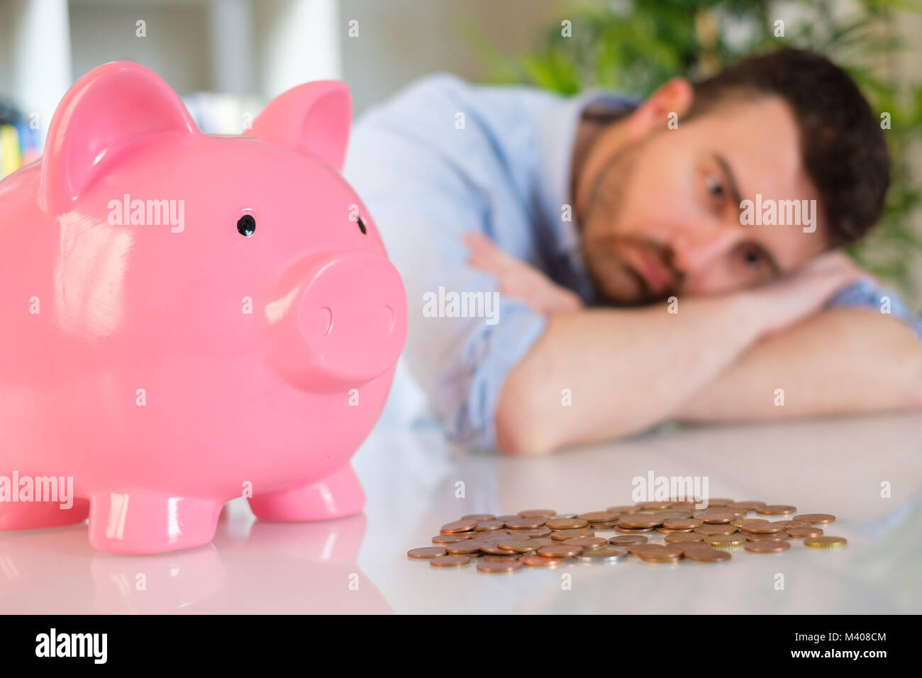 Upset man after bad investment and losing his savings - Stock Image