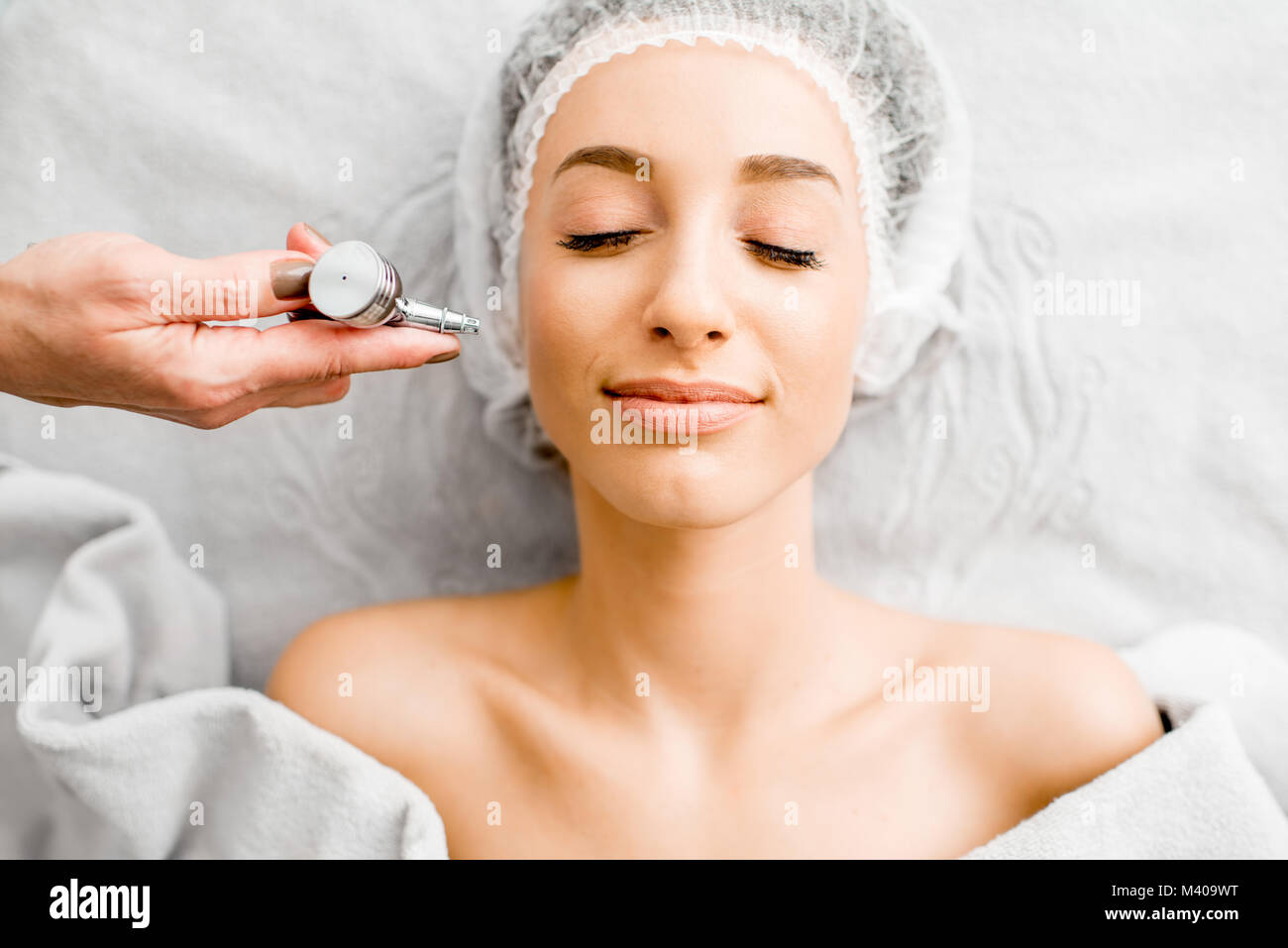 Woman during the hydration skin procedure - Stock Image