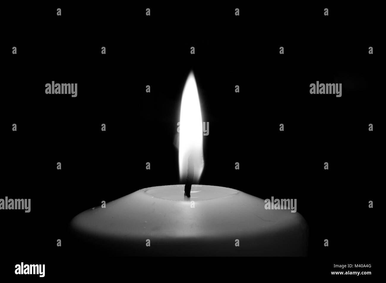 Candle Flame Isolated on Black - Stock Image