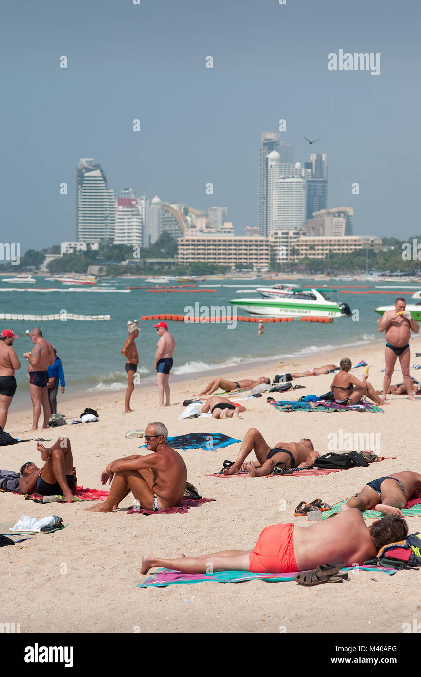 Sunbathing Pattaya Beach Thailand - Stock Image