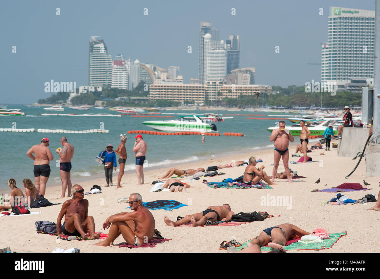Sun Worshipers Pattaya Beach Thailand - Stock Image