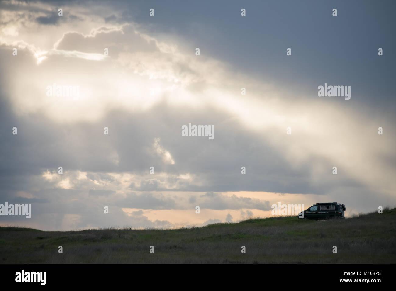 A van boondocking off road on the plains outside Spokane, Washington Stock Photo