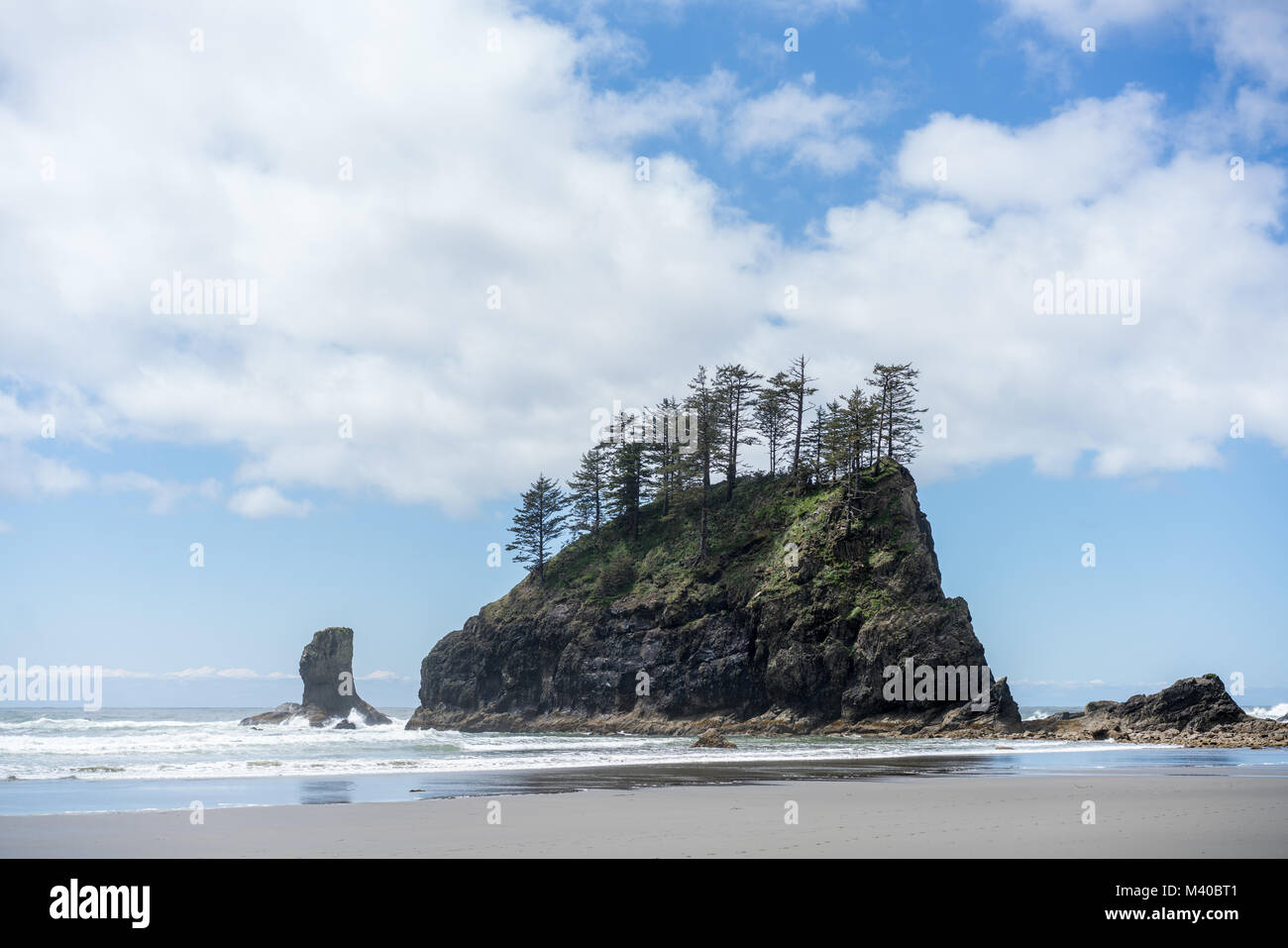 A rocky outcropping on the Oregon Coast at Cannon Beach - Stock Image