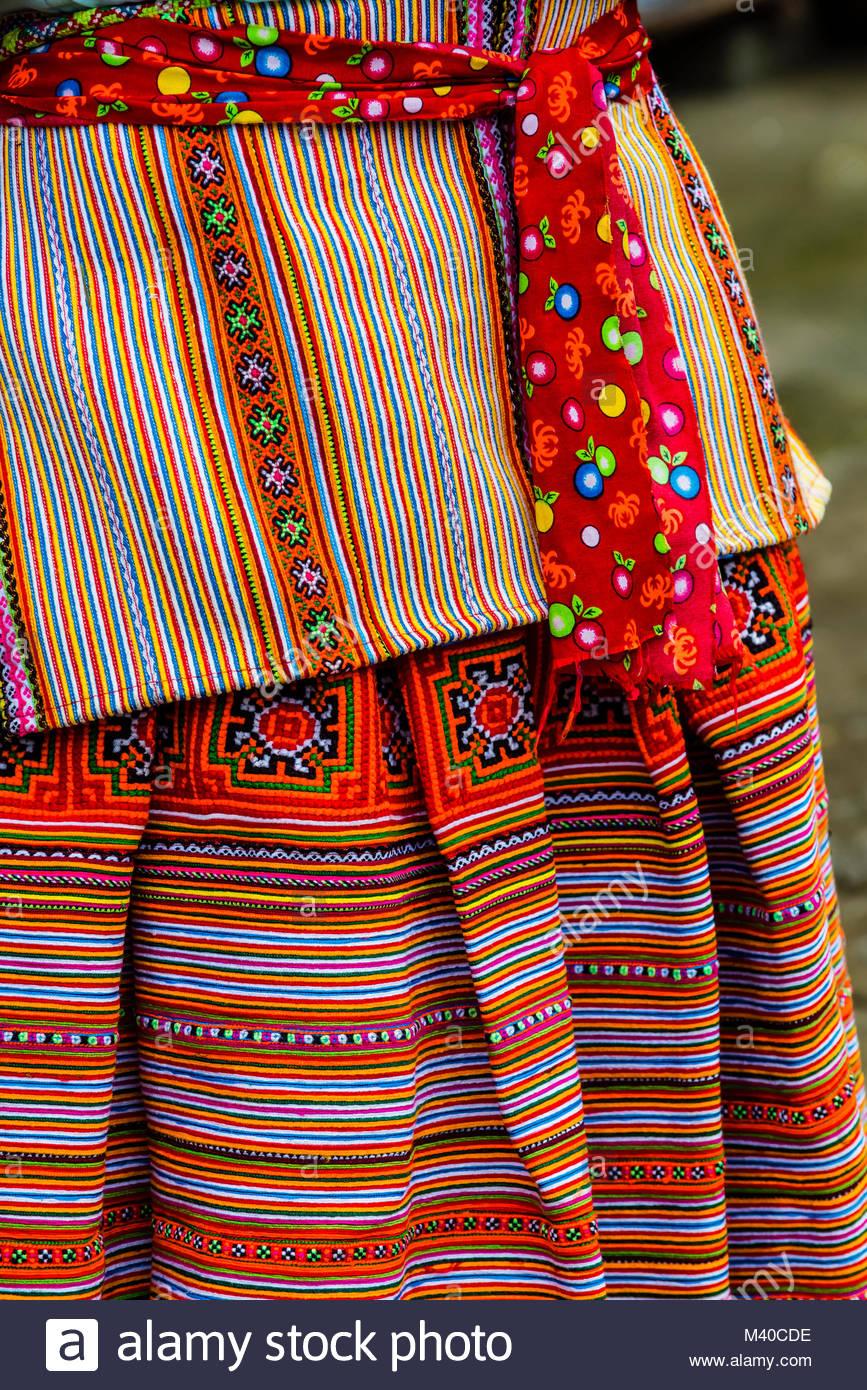 Colorful Flower Hmong (hill tribe) skirts, Sunday market at Bac Ha, northern Vietnam. Every Sunday ethnic minorities - Stock Image