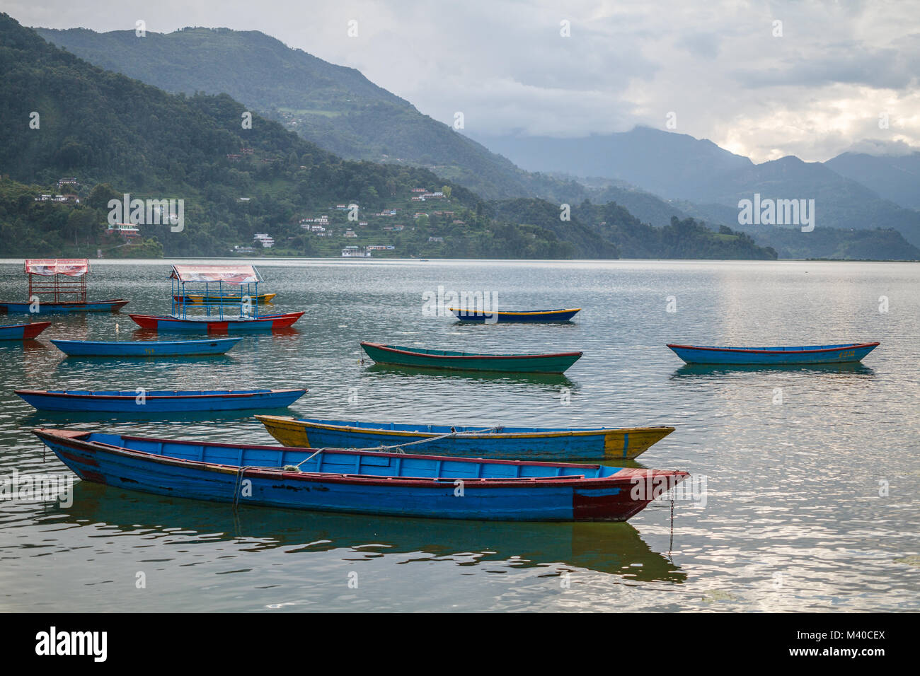 Colorful boats on Phewa Lake, Pokhara, Nepal - Stock Image
