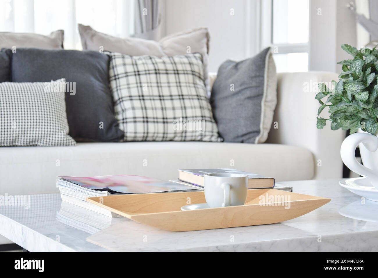decorative wooden tray with tea cup and books in modern living room ...