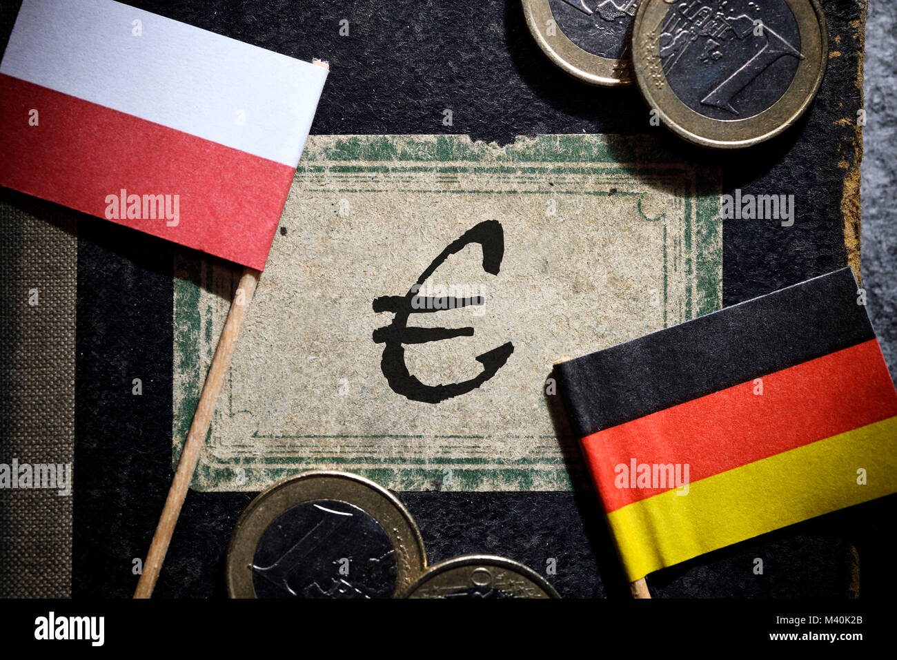 Flags of Germany and Poland and book with Euro sign, polish reparation demands, Fahnen von Deutschland und Polen Stock Photo