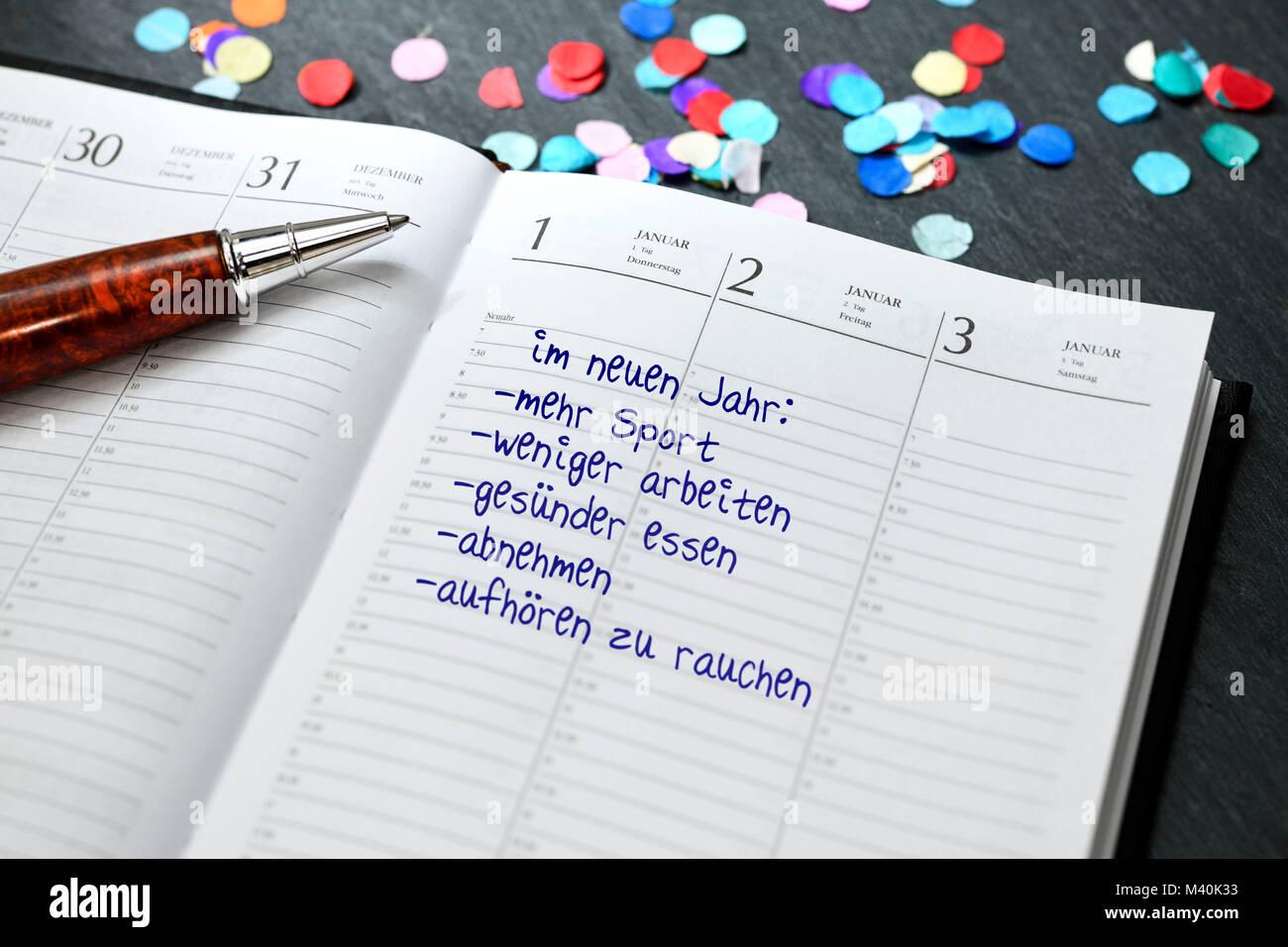 Calendar with good intentions for the new year, Kalender mit guten Vorsätzen für das neue Jahr Stock Photo