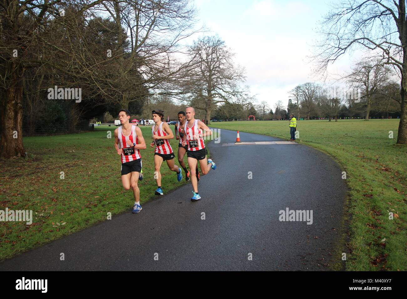 A group of male runners taking part in a race around historic Broadlands Estate near Romsey, Hampshire, England. - Stock Image