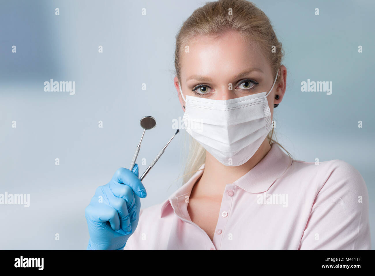 a young female dentist with dental instruments - Stock Image
