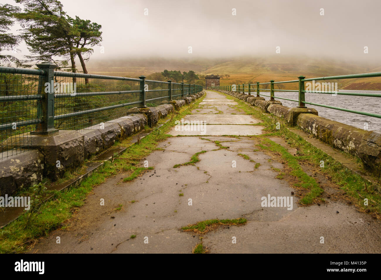 A walk on the dam of the Grwyne Fawr Reservoir in the Brecon Beacons National Park, Powys, Wales, UK - Stock Image