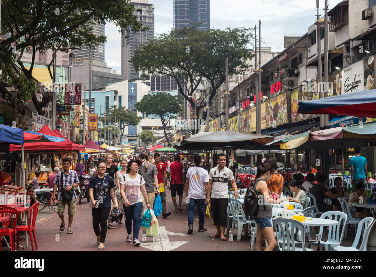 Kuala Lumpur, Malaysia - December 22 2017: Tourists and locals wander along Jalan Alor famous for its chinese food Stock Photo
