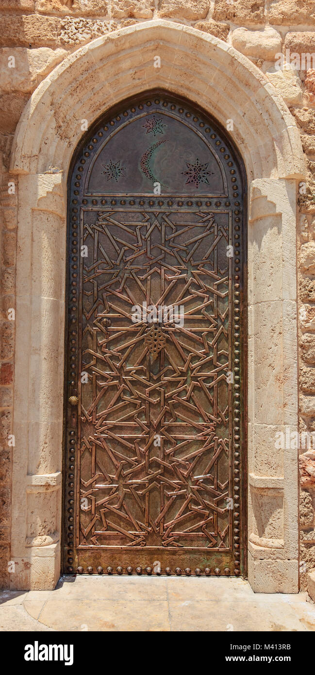 Closeup view of old metal door with oriental geometric ornament. & Closeup view of old metal door with oriental geometric ornament ...