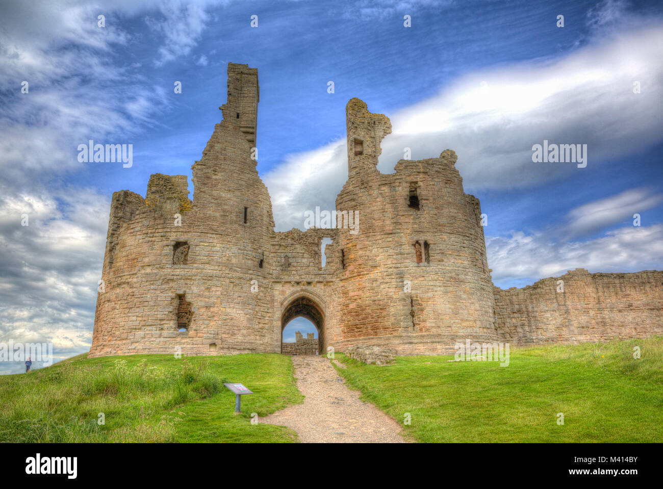 English medieval castle Dunstanburgh Northumberland England uk in colourful hdr - Stock Image