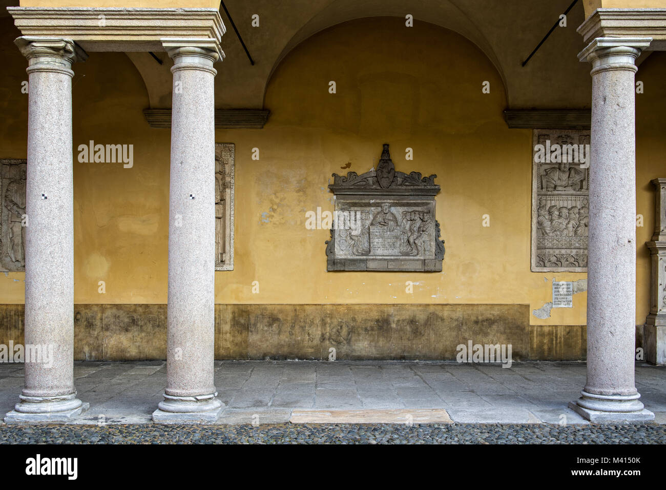 Columns and bas-relief at the University of Pavia, Lombardy, northern Italy Stock Photo