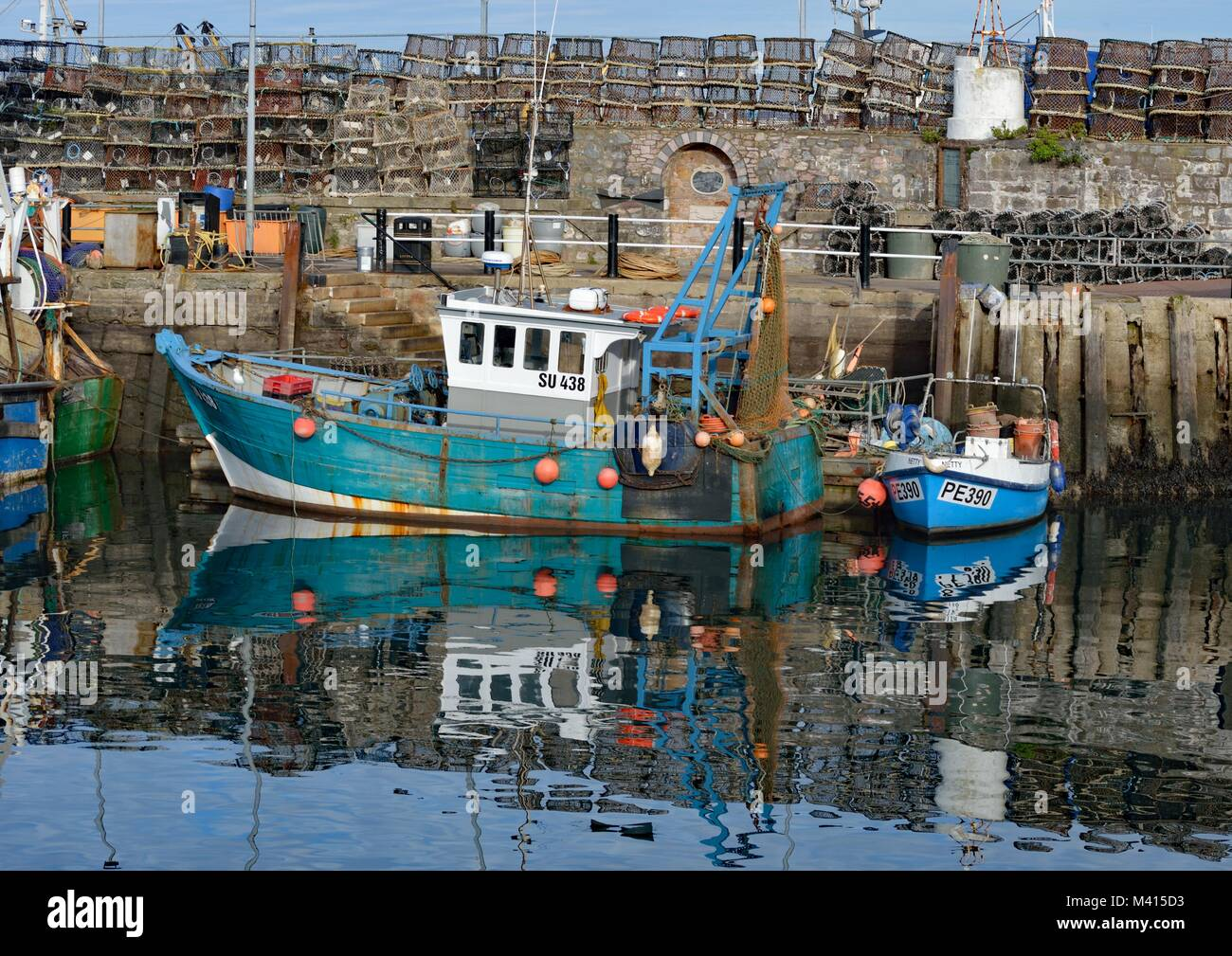 Fishing Boats (with reflection) in Brixham Harbour - Stock Image