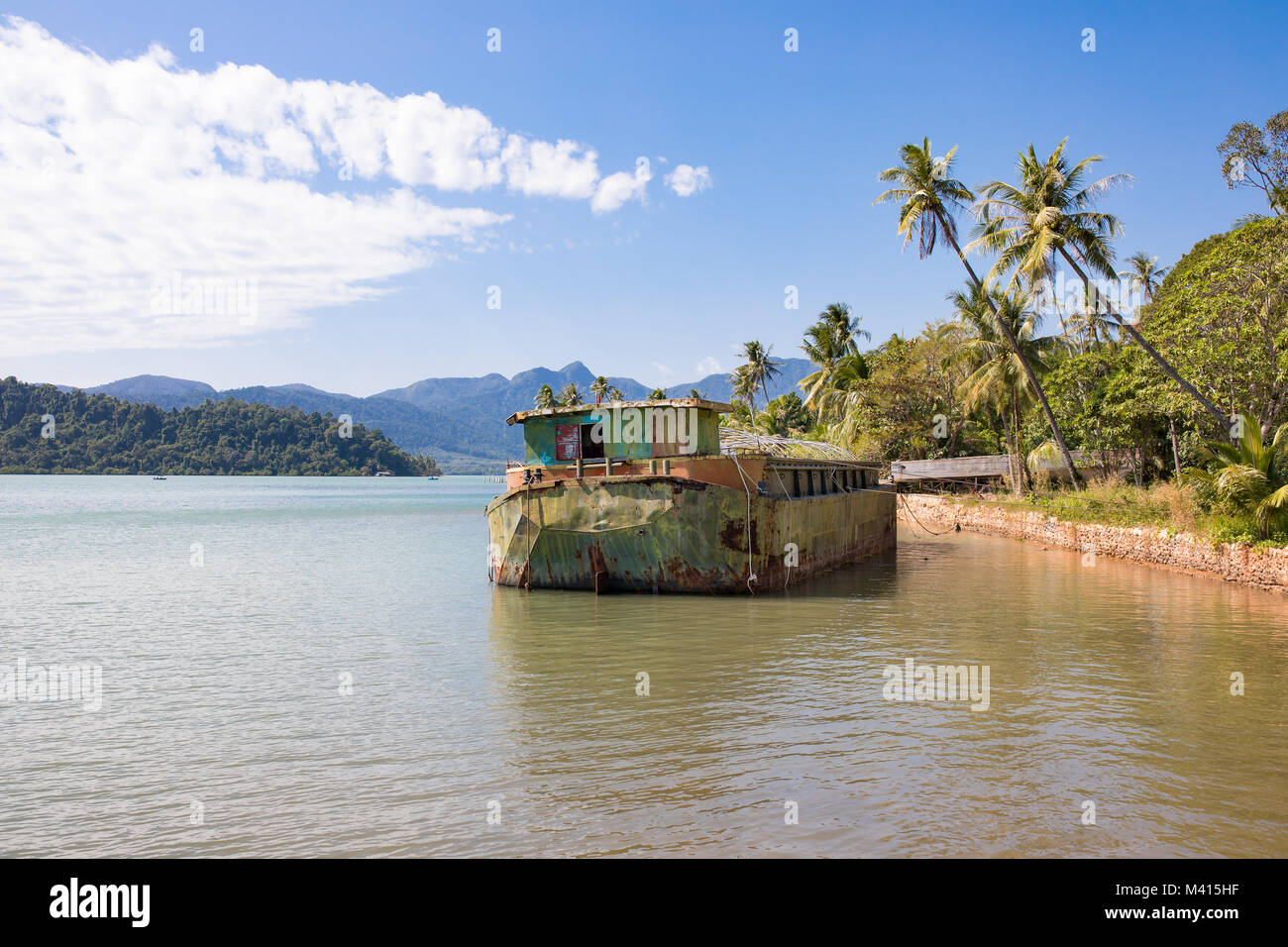 Abandoned ship wreck on sea, Southern coast of the island Koh Chang, Thailand - Stock Image