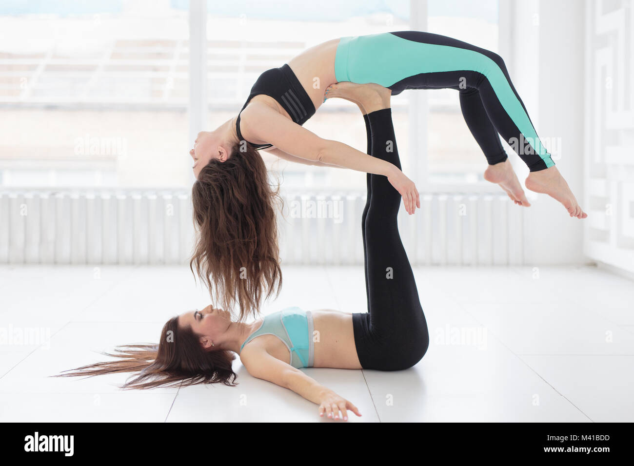 Group Of Two Fit Women Practicing Balance Yoga Pose Stock Photo Alamy