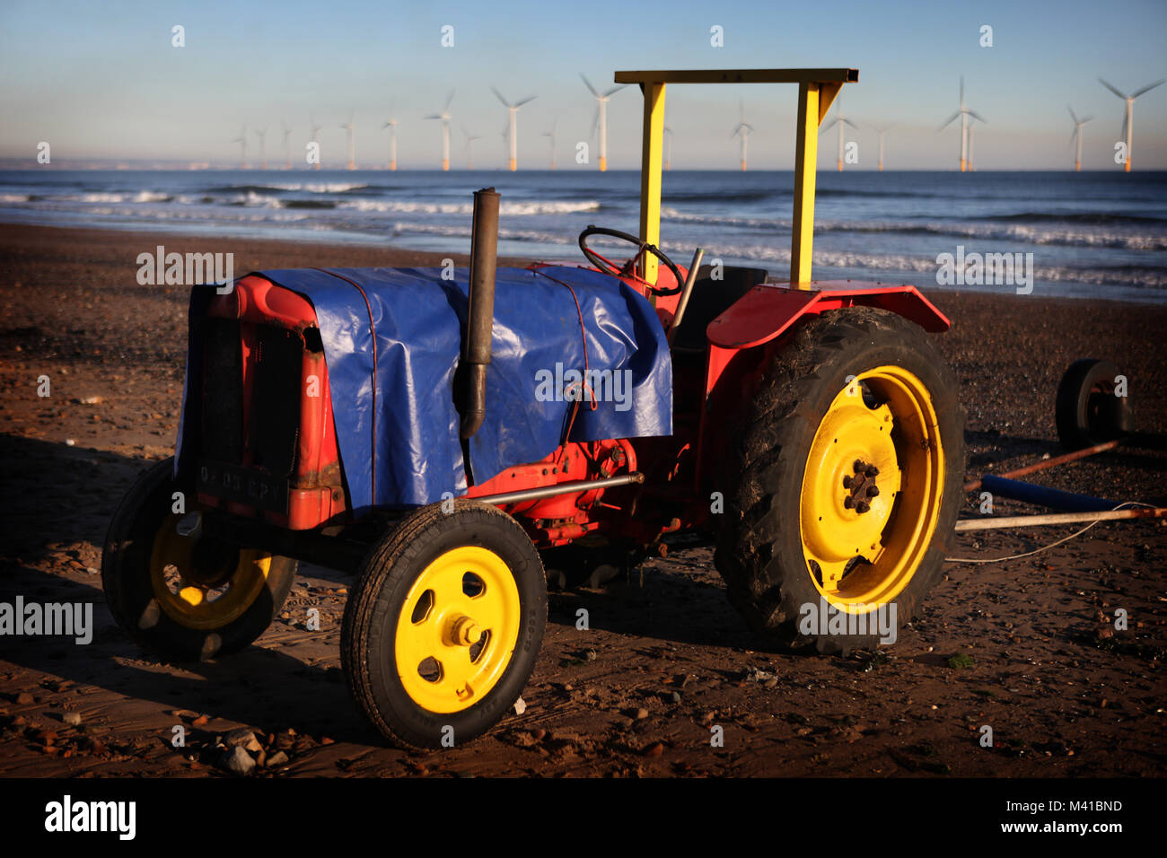 Sea-going tractors wrapped up against the elements in Redcar, Cleveland, England, Britain Stock Photo