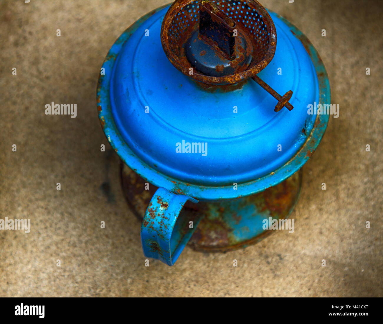 Everyday objects in the Museum and the abandoned old houses. Old blue kerosene lamp without glass - Stock Image