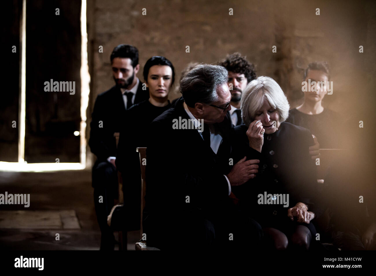 Senior woman being comforted at a funeral - Stock Image