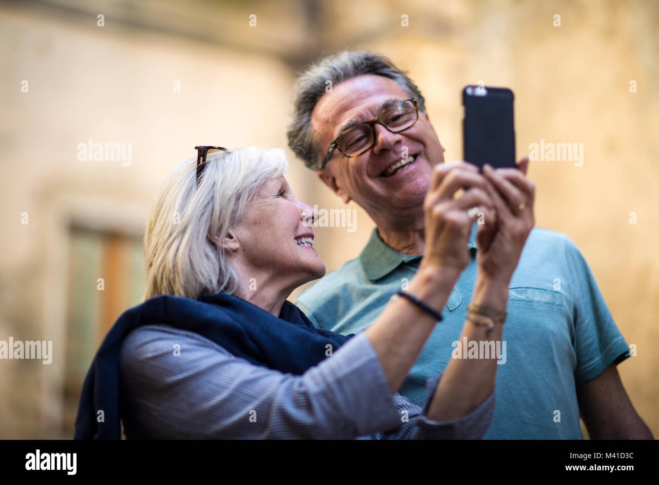 Senior couple on vacation taking a selfie Stock Photo