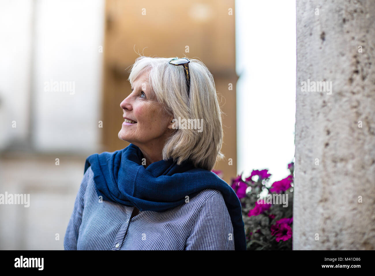 Senior woman on vacation looking at a tourist site - Stock Image