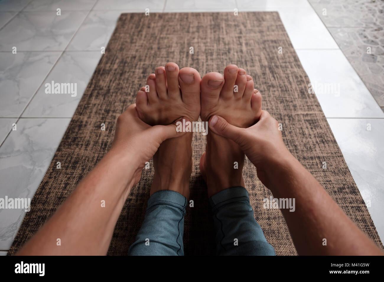Paschimottanasana or seated forward bend yoga pose - Stock Image