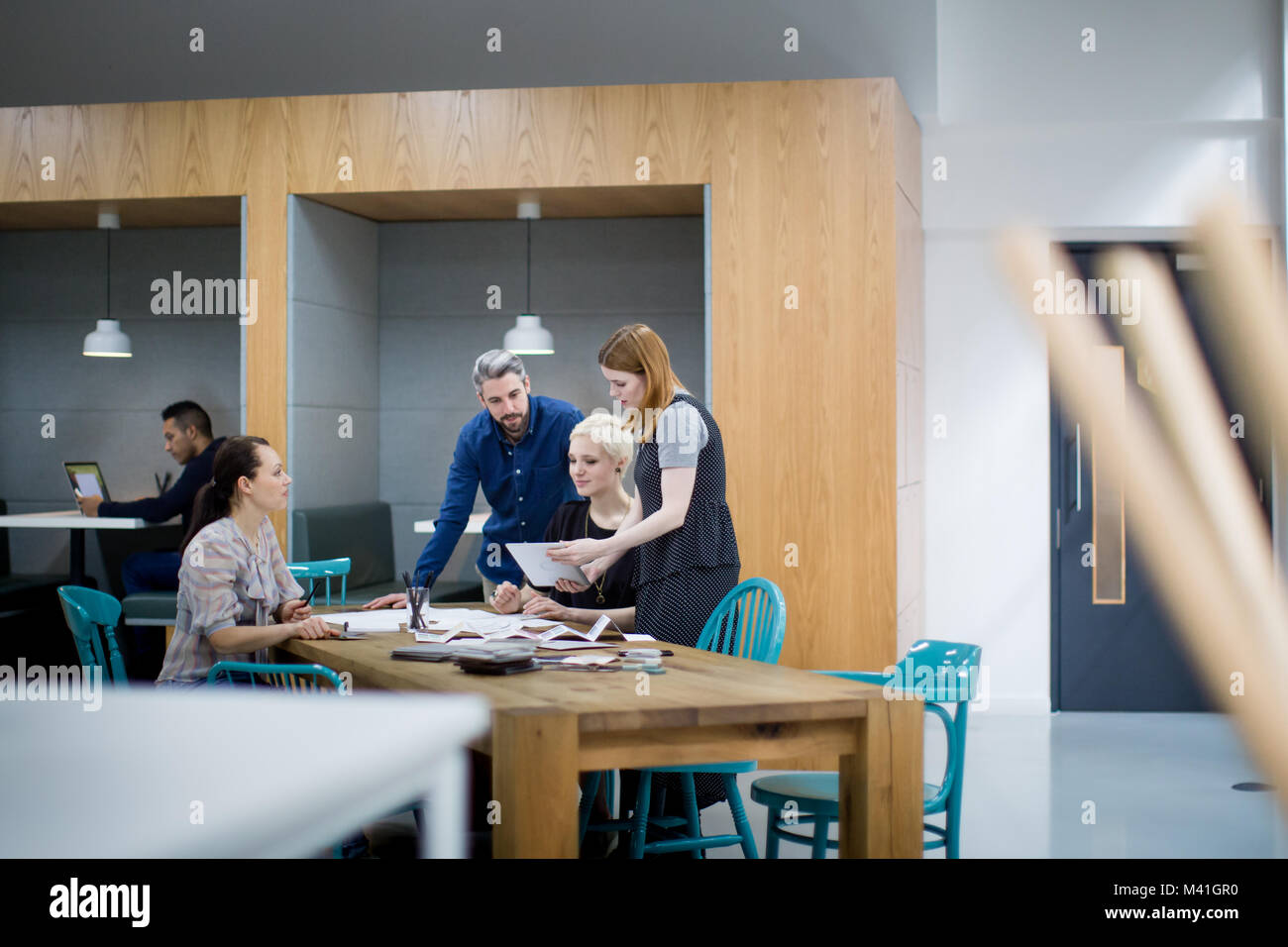 Group of coworkers discussing a project - Stock Image