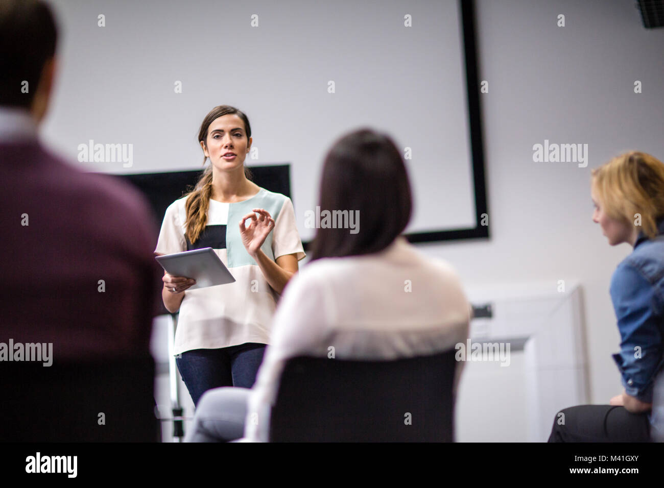 Female executive leading a  training conference - Stock Image