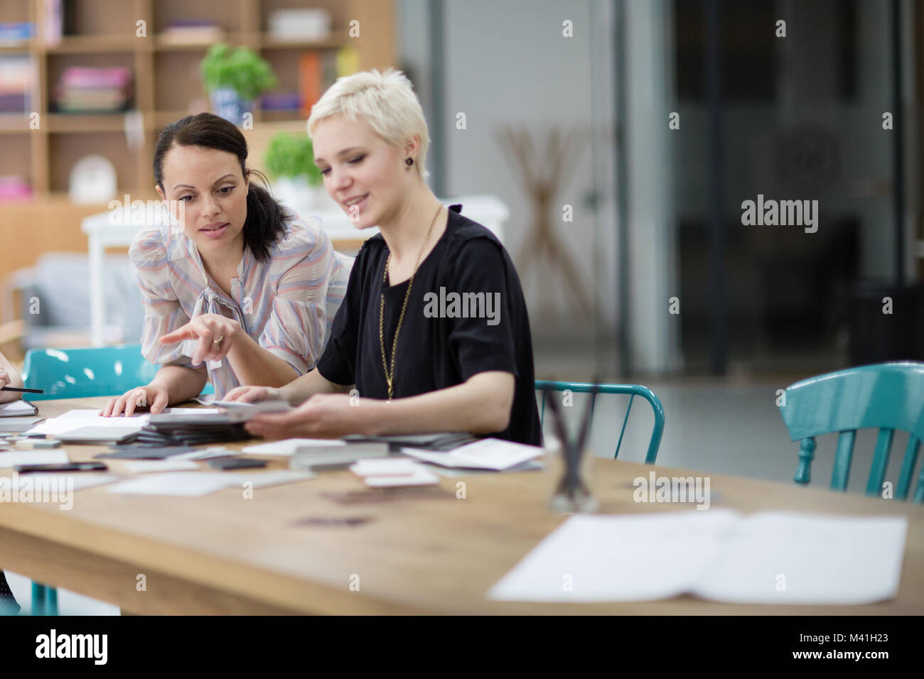 Female designers working on a project - Stock Image