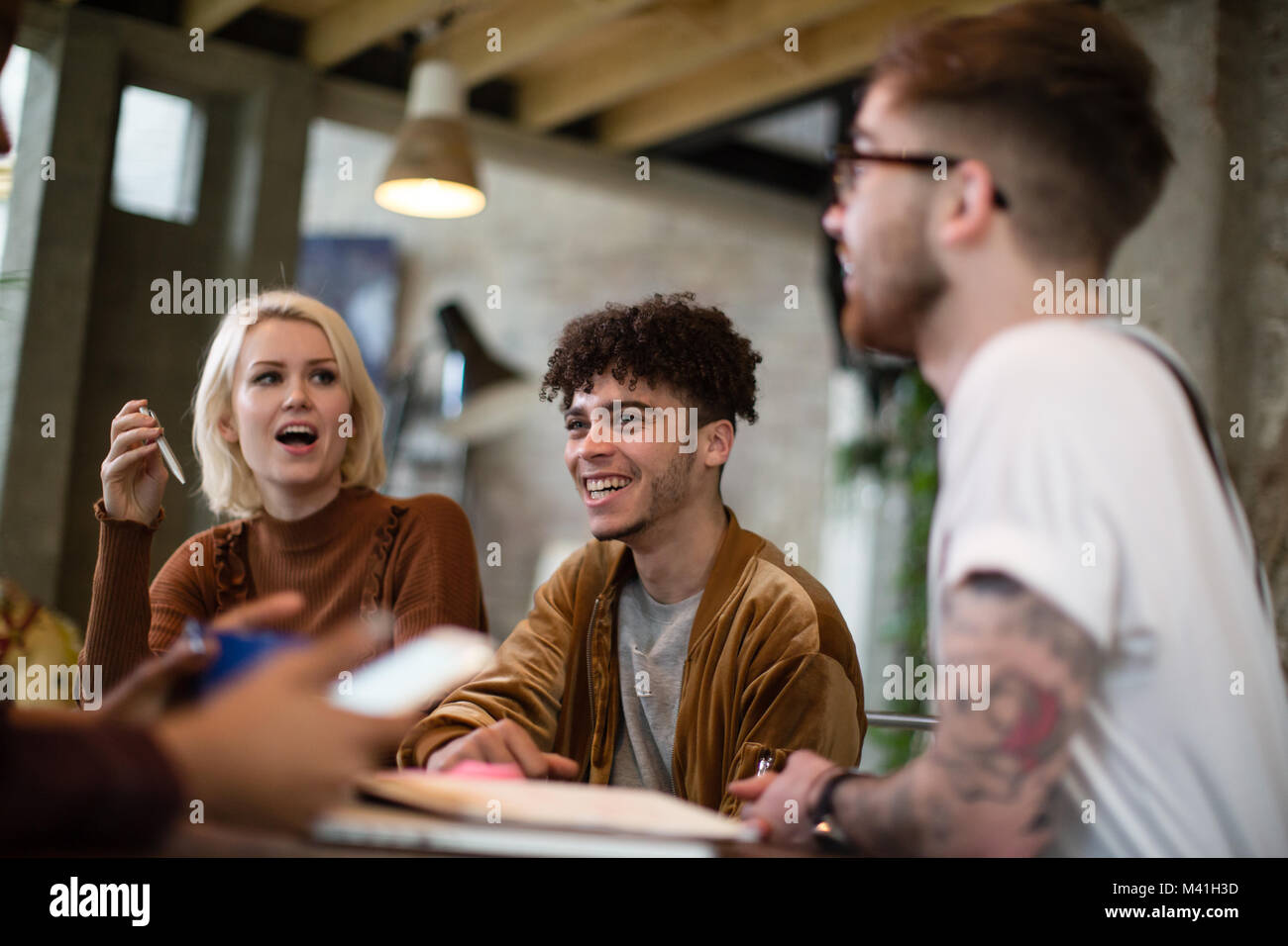 Group of young entrepreneurs in a meeting - Stock Image