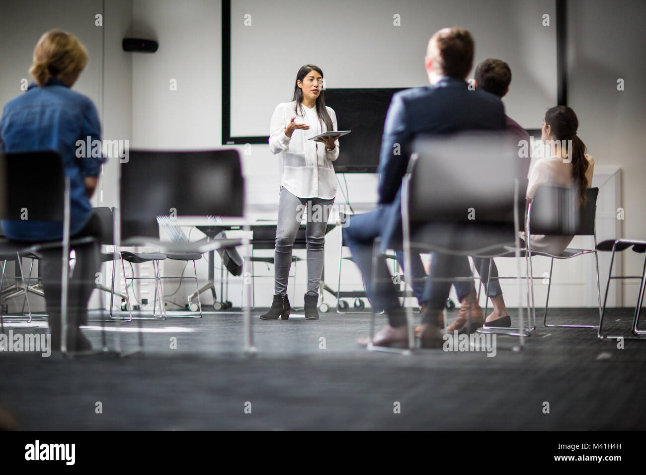 Female executive leading a  training conference - Stock Image