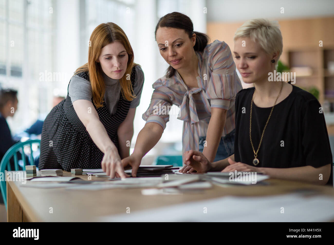 Female coworkers working on a project - Stock Image