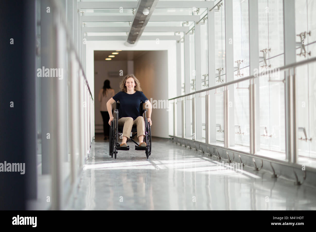 Disabled businesswoman on her way to work - Stock Image