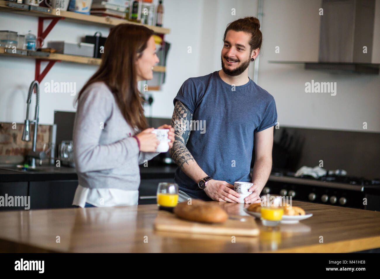 Young couple enjoying breakfast together - Stock Image