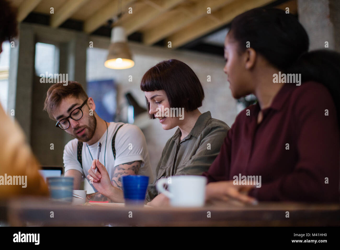 Group of young entrepreneurs working together - Stock Image