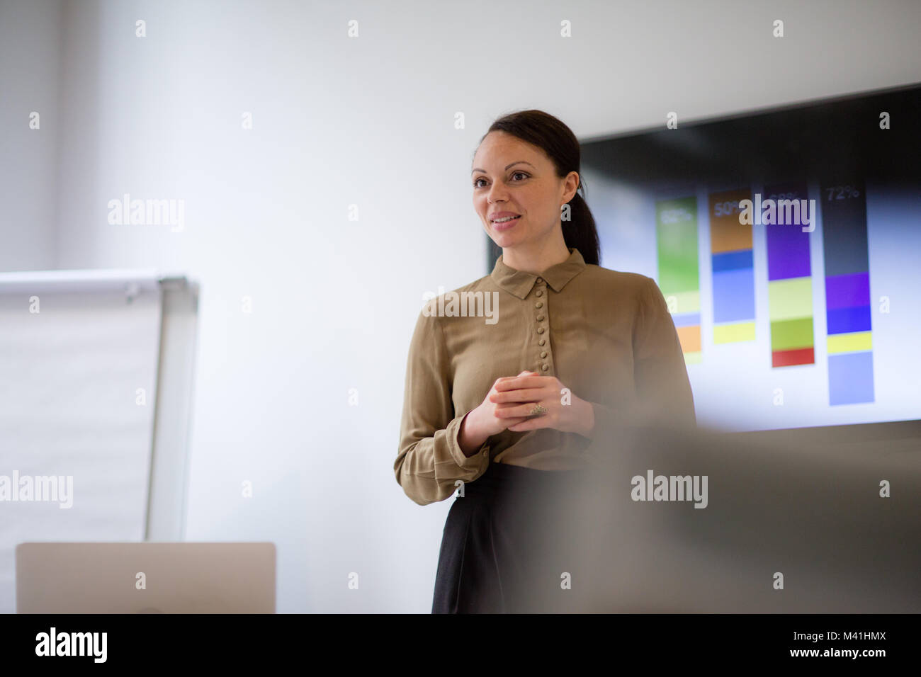 Female business executive giving a presentation - Stock Image