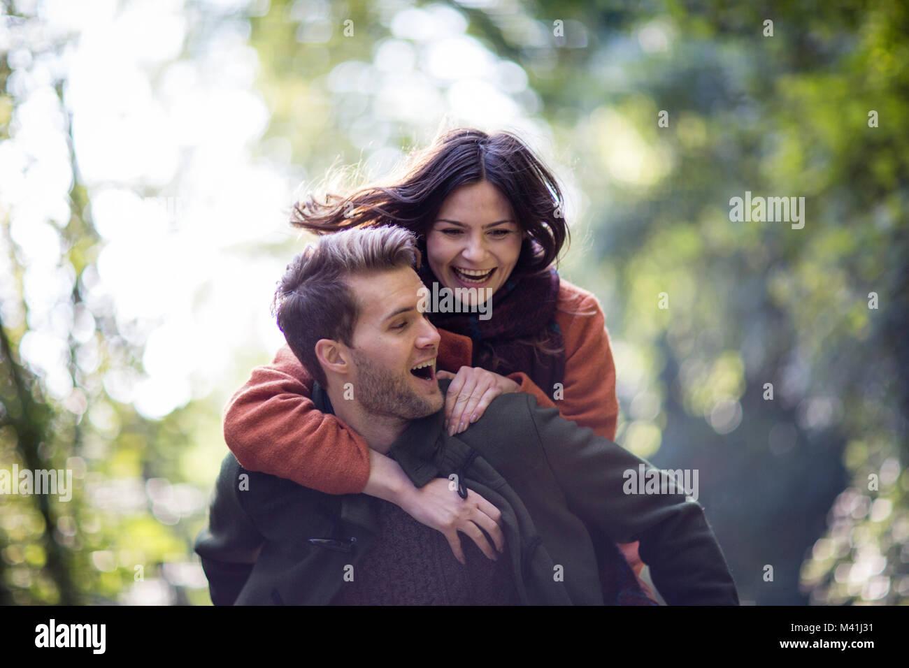 Couple having fun outdoors in autumn - Stock Image