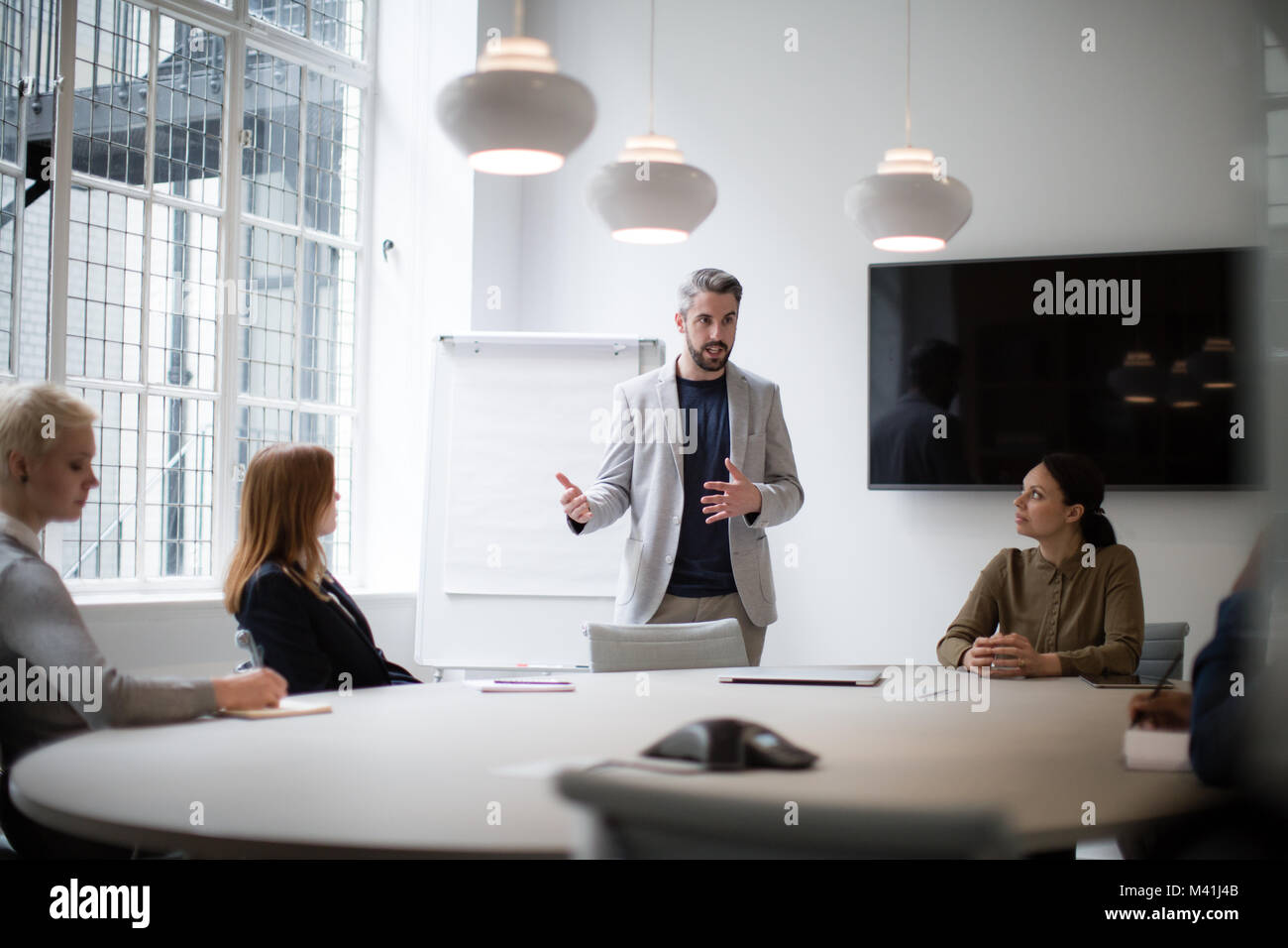 Male business executive giving a presentation - Stock Image